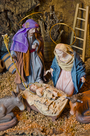 st  joseph: Nativity Crib. Figures of Baby Jesus, Virgin Mary and St. Joseph. Stock Photo