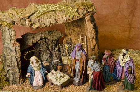 Nativity Crib. Figures of Baby Jesus, Virgin Mary, St. Joseph and the Three Wise Men photo