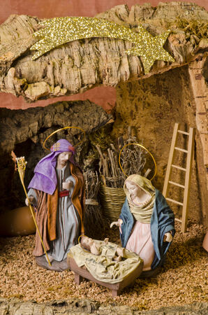 Christmas Crib. Figures of Baby Jesus, Virgin Mary and St. Joseph.  Stock Photo