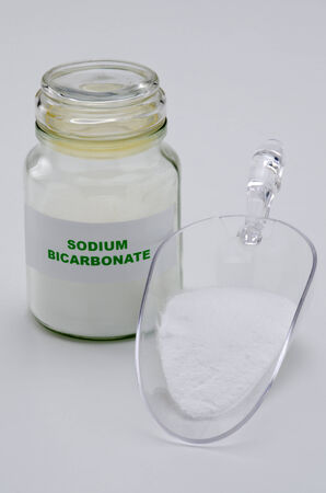 sodium: Sodium bicarbonate in a glass jar. White background.