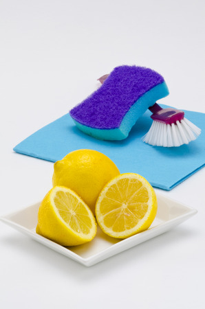 Lemon is used for cleaning metal surfaces, dishes and clothes photo