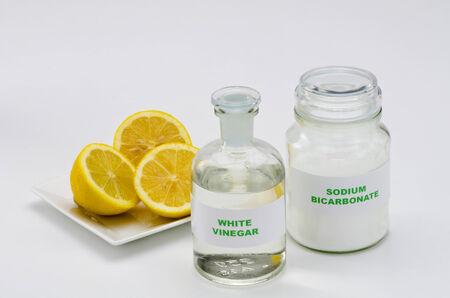 Organic cleaners. White vinegar, lemon and sodium bicarbonate. Stock Photo