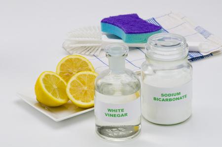 Organic cleaners. White vinegar, lemon and sodium bicarbonate. photo