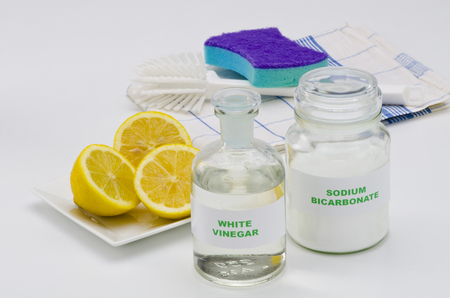 sodium bicarbonate: Organic cleaners. White vinegar, lemon and sodium bicarbonate. Stock Photo