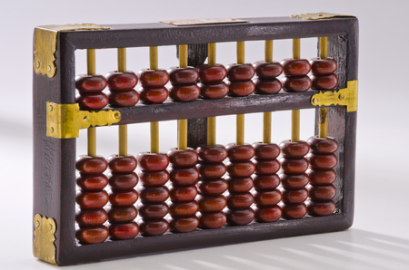 calculator chinese: Old chinese abacus on white background.