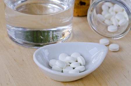 Magnesium capsules. Dietary supplements. Selective focus. Taken in daylight.