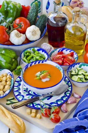 andalusian cuisine: Spanish Cuisine. Gazpacho. Andalusian cold soup served in a ceramic bowl. Taken in daylight. Selective Focus. Stock Photo