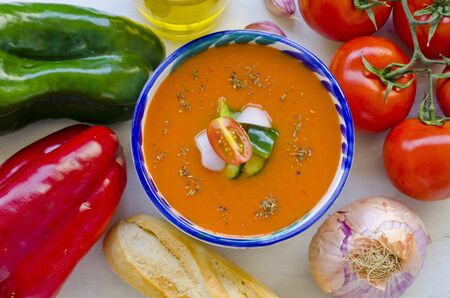 andalusian cuisine: Spanish Cuisine. Gazpacho. Andalusian cold soup served in a ceramic bowl. Taken in daylight.