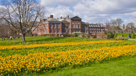 incidental people: London, United Kingdom - March 31, 2015: Kensington Palace and Gardens in early spring. Incidental people.