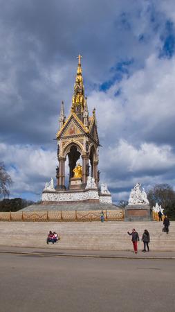 incidental people: London, United Kingdom - March 31, 2015:The Albert Memorial in  Kensington Gardens. Incidental people. Editorial
