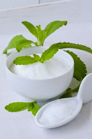 sweetener: Stevia Powder and Fresh Leaves. Natural sweetener. Selective Focus. Taken in daylight.