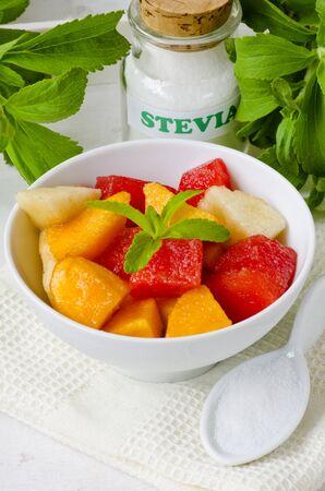 sweetener: Fruit Salad and Stevia Powder. Natural sweetener. Selective Focus. Taken in daylight.