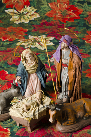 st  joseph: Christmas Crib. Figures of Baby Jesus, Virgin Mary and St. Joseph Stock Photo