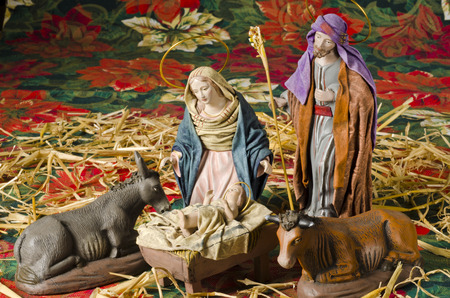 Christmas Crib. Figures of Baby Jesus, Virgin Mary and St. Joseph Stock Photo