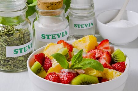 Stevia powder and fruit salad bowl.  Natural sweetener. Selective Focus.