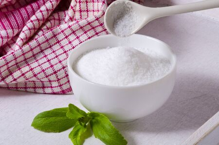Stevia powder pouring into a bowl. Natural sweetener. Selective Focus. Stock fotó