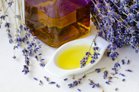 Lavender essential oil on a small bowl. Selective focus. Taken in daylight. Stock Photo