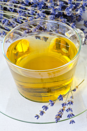 vertical wellness: Lavender herbal teal on a glass cup. Selective focus. Taken in daylight. Stock Photo