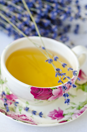 vertical wellness: Lavender herbal teal on a china cup. Selective focus. Taken in daylight. Stock Photo