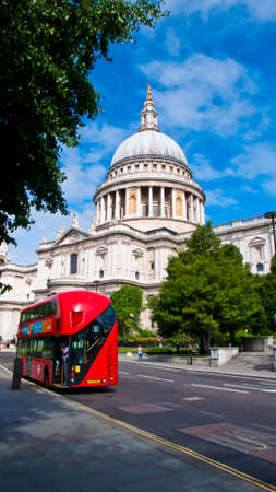 incidental people: London, United Kingdom -  July 24, 2016. View of St. Pauls Cathedral and Gardens and red double deck bus.