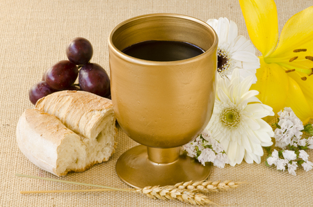 First Holy Communion composition on beige sackcloth background. Stock Photo