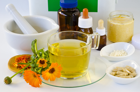 Alternative Medicine. Marigold products and first aid box in background. Stock Photo