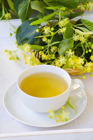 Alternative Medicine. Herbal Therapy. Lime blossom tea in a cup. White background. Stok Fotoğraf - 132001269