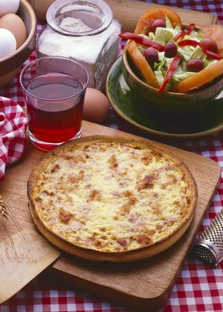 French Cuisine. Baked homemade Quiche Lorraine with eggs, bacon and cheese.