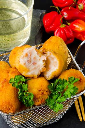 Spanish Tapas. Fried Ham Croquettes in a basket. Croquetas de jamon.