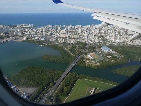 Aerial view of Old San and the tip of the Puerto Rico International Airport, seen from an airplane window.
