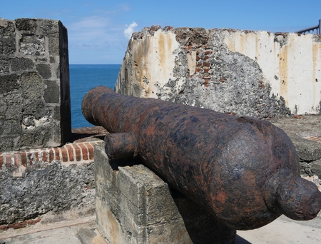 Old cannon pointing out to sea at El Morro Fort, Old San Juan, Puerto Rico