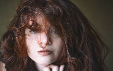 lipstick: Close up portrait of a red-haired woman