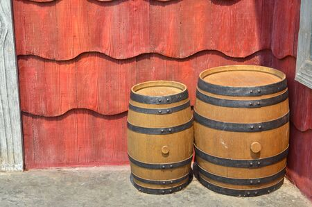 three objects: Wooden barrel in cartoon style on red background