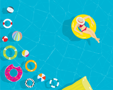 Relax young woman with colorful swim ring beach ball in the resort swimming pool