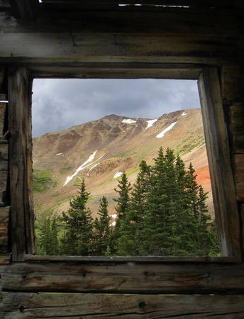 a high altitude mining camp with a room with a beautiful view of the high peaks of the colorado rockies