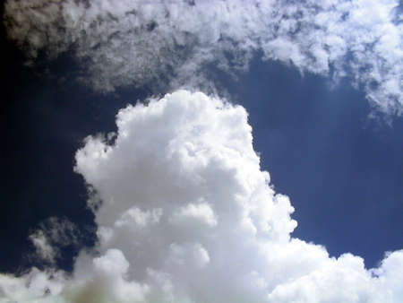 godly: Sun Rays through the clouds,clouds in manny shapes Stock Photo