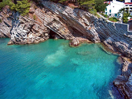 Beautiful scenery, with the amazing blue sea and the curious rock shapes. Reklamní fotografie