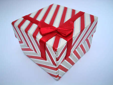 Fancy gift-box with red ribbon isolated on white background