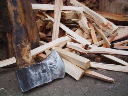 kindling: axe and choped  firewood in background Stock Photo