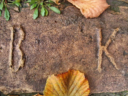 autograph:  Initials on the Old Brick