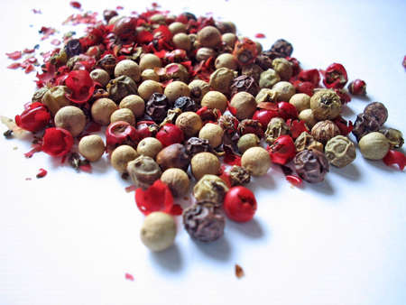 Close up of red, black, green and white pepper