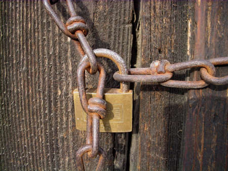 Old padlock and rusty chain photo