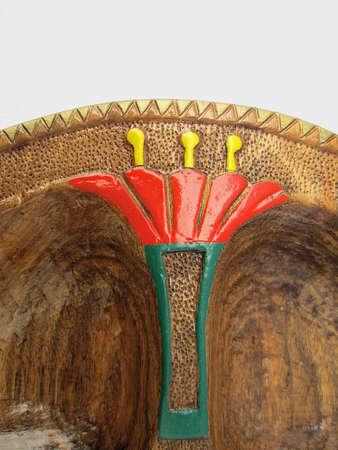 Decorative wooden bowl,ORNAMENT SCULPTURE IN PAINTED WOOD,detail Reklamní fotografie