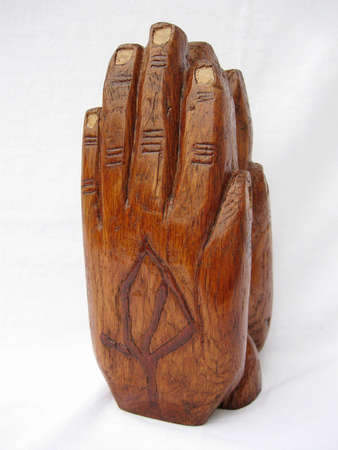 hand carved: sculpture of hands praying