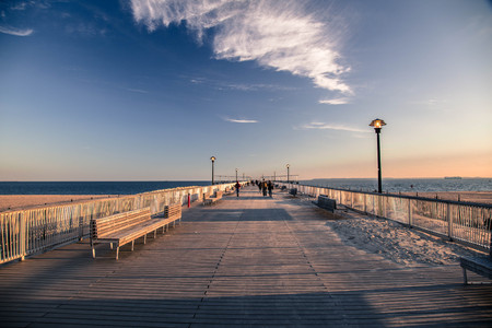 A pier at Coney Island on a bright brisk winter day Editorial
