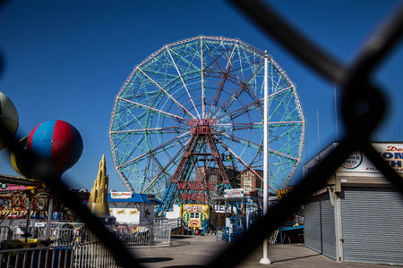 THe Wonder Wheel at Coney Island in winter, seen through a fence Editorial