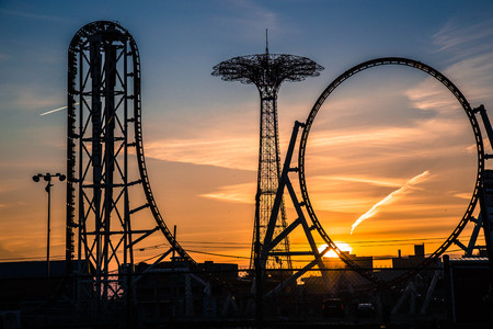 Sunset over attractions at Coney Island Stock Photo