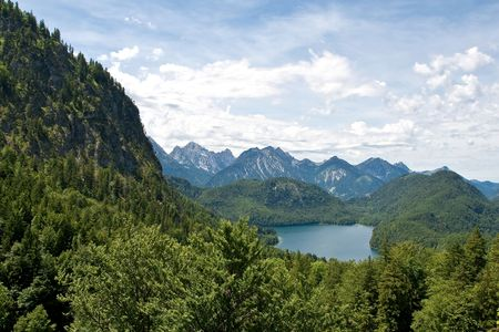 Lake and mountains near Neuschwanstein Castle in Fussen Germany photo