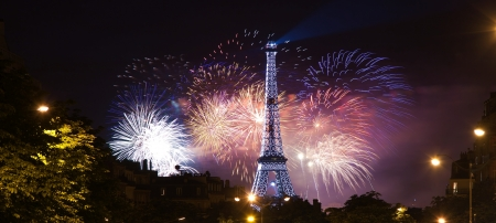 bastille: Paris, France - July 14, 2012: Eiffel Tower night view in Bastille Day fireworks