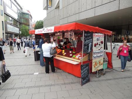 A cherries kiosk on a popular shopping avenue, Munich, Germany